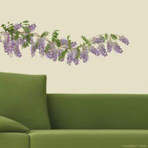 Sticker adhésif fleur Glycines au-dessus d'un canapé
