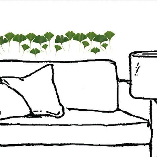 Sticker feuilles vertes pour déco au dessus d'un canapé