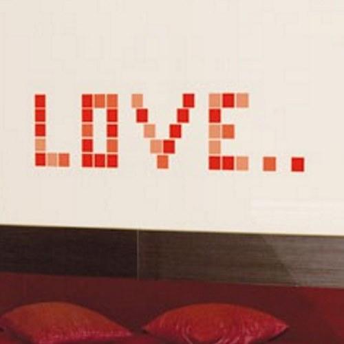 Décoration murale citation pixels rouge avec des stickers pixels.