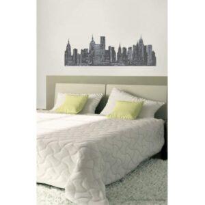 sticker mural panorama de ville en noir et blanc mis en ambiance sur un mur clair