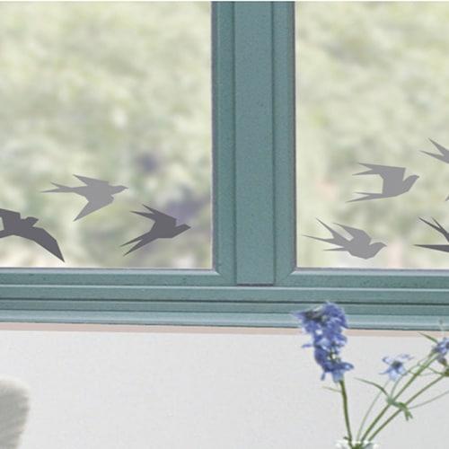 Sticker adhésif hirondelles grises pour fenêtre