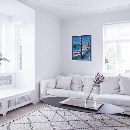 Autocollant mural fenêtre avec vue sur un port de pêche mis en ambiance dans un salon aux murs blancs