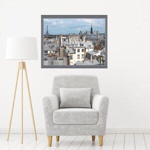sticker Toits de Paris au-dessus d'un fauteuil gris et lampe design