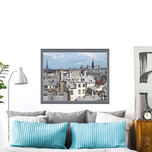 sticker Toits de Paris au-dessus d'un canapé gris et bleu