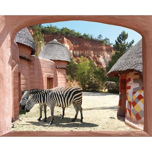 Déco aventure pour la tête de lit avec une fausse fenêtre adhésive safari en Afrique.