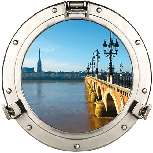Sticker fausse fenêtre ronde avec une vue sur le Pont de Pierre comme un faux hublot de bateau en tompe-l'oeil.