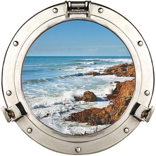 Fausse fenêtre adhésive en trompe-l'oeil en forme de hublot de bateau donnant une vue sur les sables d'olonne.