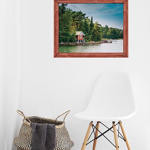Jolie entrée personnalisées avec un cadre comme une fausse fenêtre de cabane en trompe-l'oeil donnant la vue sur un joli paysage du Canada.