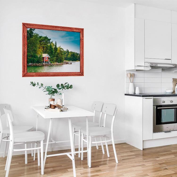 Sticker fenêtre trompe l'oeil Laurentides sur un mur blanc de cuisine