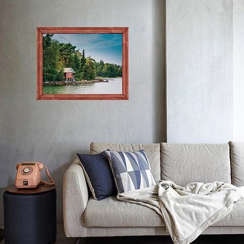 Salon aux murs gris personnalisé avec un Adhésif fenêtre en trompe l'oeil offrand la vue sur Laurentides au Canada.
