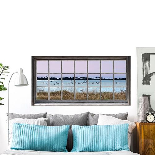 sticker fenêtre avec une vue sur des flamands roses