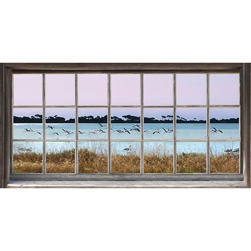 Déco murale sticker fenêtre avec une vue sur des flamands roses, mis en ambiance sur un mur blanc