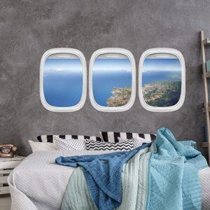 Sticker Vue du Ciel pour tête de lit sur mur gris au-dessus d'un lit avec plaids colorés