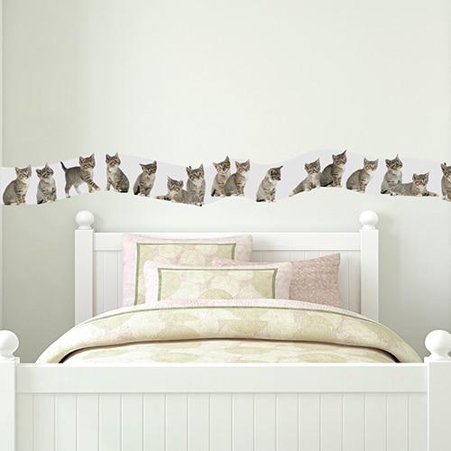 Sticker frise chatons au-dessus d'un lit