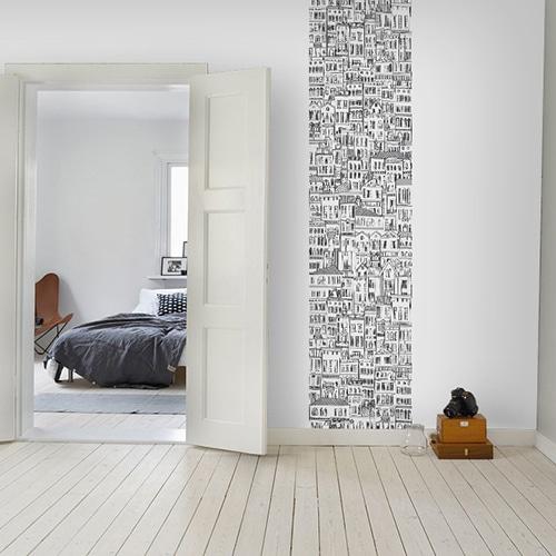 sticker mural géant immeubles à colorier mis en ambiance sur un mur blanc