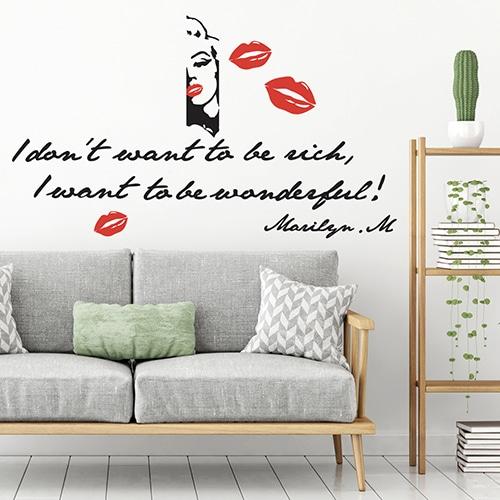 Stickers planche Marilyn Monroe au-dessus d'un canapé gris dans un salon