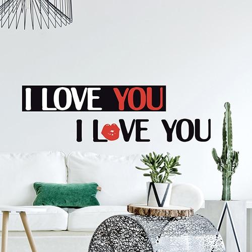 Stickers planche I love You au-dessus d'un canapé blanc