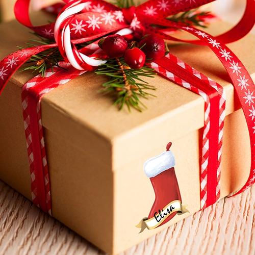 Sticker Étiquettes Cadeaux mise sur un paquet cadeau de noel