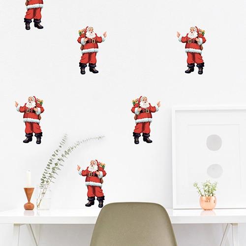 Sticker Père Noël collé sur un mur blanc au-dessus d'une table