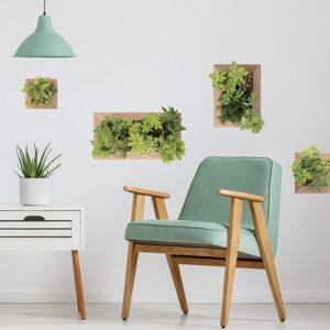 Quatre stickers faux Jardin Vertical au-dessus d'un fauteuil vert dans un salon