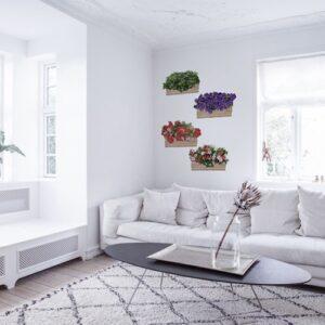 stickers Fleurs au balcon dans un salon au-dessus d'un canapé blanc