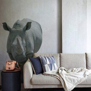 Sticker Mural Rhinocéros positionné sur le mur d'un salon