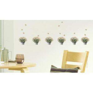 Stickers de pot de fleurs pâquerettes coller dans une salle a manger