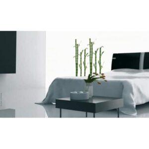 Sticker bambou zen dans une chambre avec lit blanc