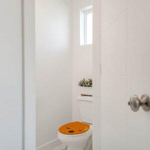 Sticker autocollant Smiley endormi Orange collé aux WC