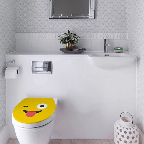Sticker adhésif Smiley langue jaune sur WC