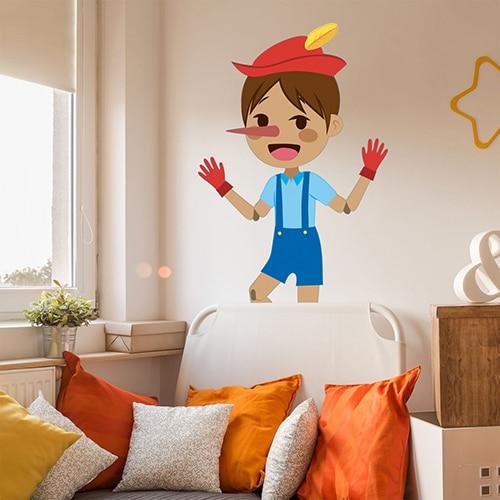 Sticker mural Pinocchio pour enfants mis en ambiance dans une chambre aux murs clairs
