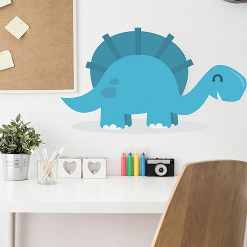 adhésif mural Dinosaure Bleu pour enfants mis en ambiance sur un mur blanc