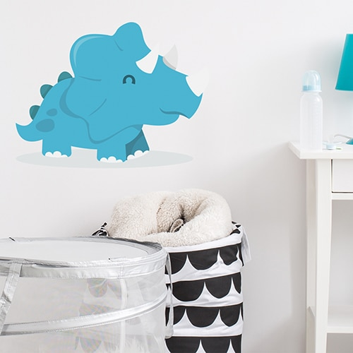 Sticker Dinosaure Bleu pour enfants avec ombre mis en ambiance sur mur blanc