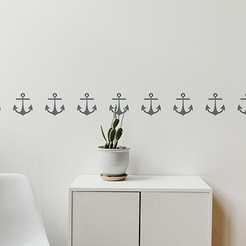 Bandes de stickers ancre gris foncé mis en ambiance sur fond blanc