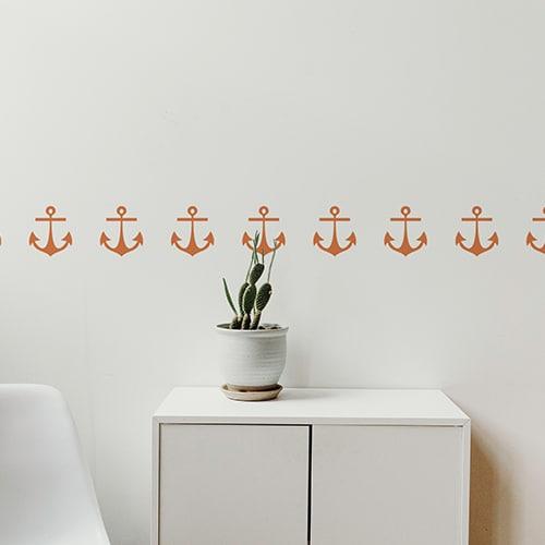 Bandes de stickers ancre orange mis en ambiance sur fond blanc