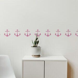 Bandes de stickers ancre rose mis en ambiance sur fond blanc