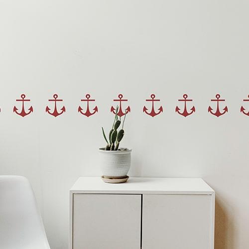 Bandes de stickers ancre rouge mis en ambiance sur fond blanc