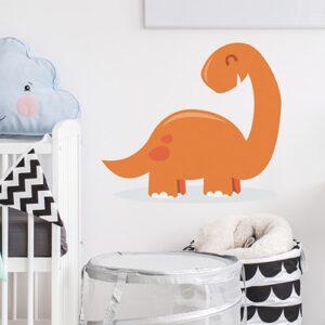 Sticker Dinosaure orange pour enfant mis en ambiance dans une chambre de bébé