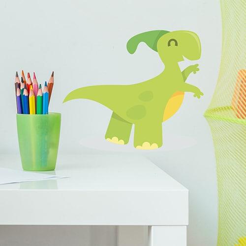 Sticker Dinosaure vert pour enfants à côté de crayons de couleur