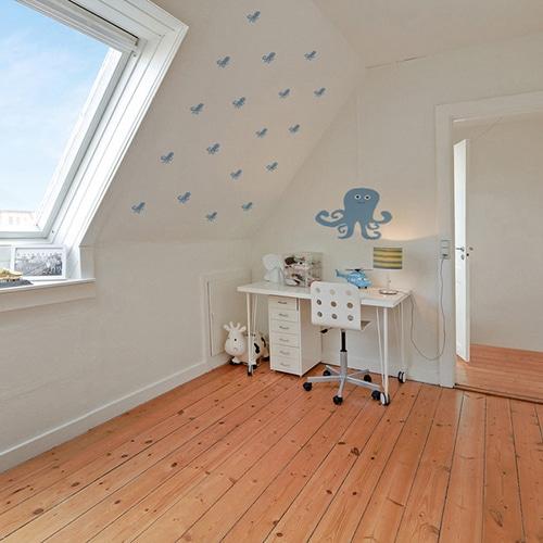Mosaïque de stickers muraux pieuvre bleue pour enfant sur le mur blanc d'un bureau pour enfant
