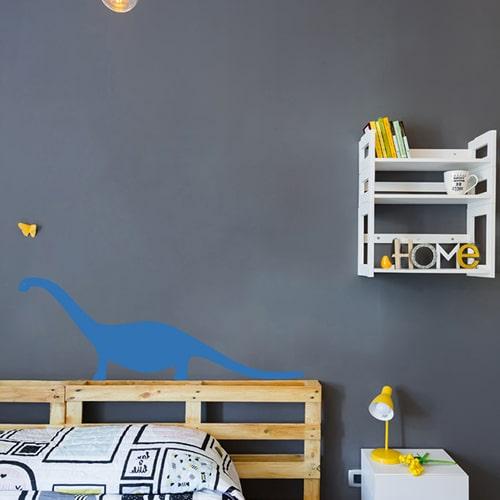 Sticker autocollant Dino Bleu pour enfant collé au mur d'une chambre