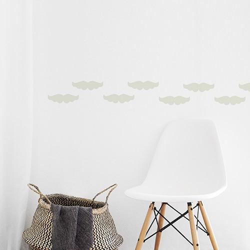 Stickers muraux frise pour murs moustache beige !