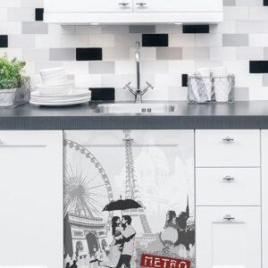 Sticker adhésif Paris sur un lave vaisselle dans une cuisine