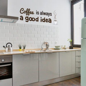 Sticker marron citation coffee is always a good idea collé dans une cuisine