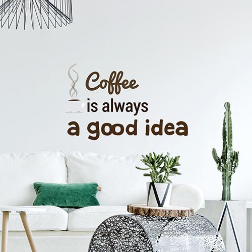 citation autocollante coffee is always a good idea collé au mur d'un salon moderne