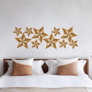 Sticker planche Etoiles dorées au dessus d'un lit