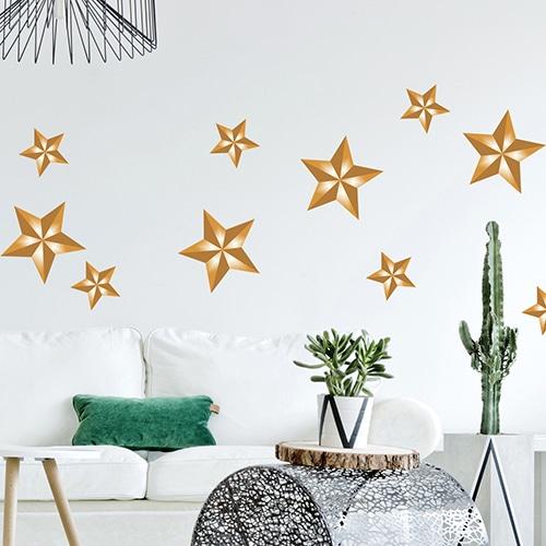 Sticker planche adhésif Etoiles dorées au dessus d'un canapé