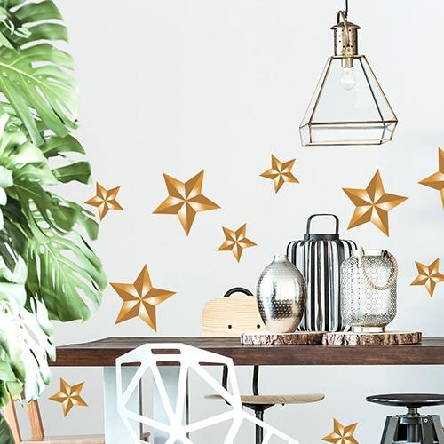 Stickers adhésifs Etoiles dorées au dessus d'une table à manger