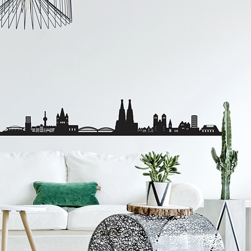 Sticker adhésif Skyline Cologne derrière un canapé