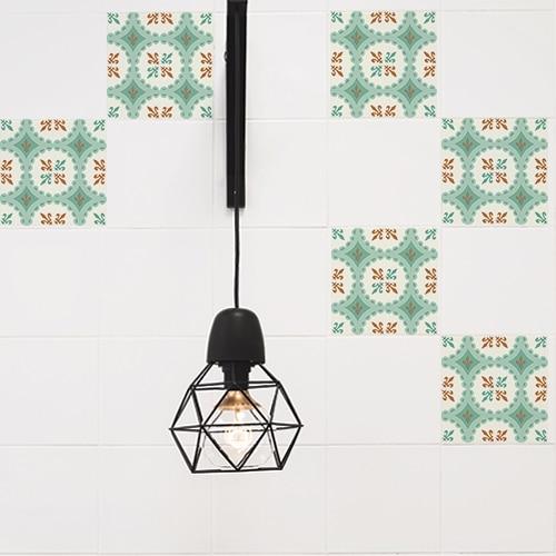 Sticker vert et orange déco pour carrelage de murs à côté d'une lampe